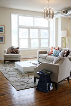 this is how our living room would look with the floor changed to wood. love the area rug and the colorful pillows
