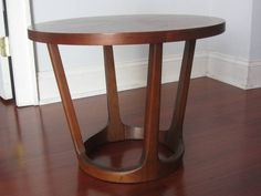 I have a Mid Century Modern Lane walnut round coffee table. It is in good condition, but there is a ding as you can see in one of the photos. Cash only.