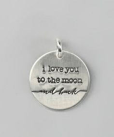 Silver charm saying:I love you to the moon......