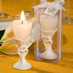 Bride and Groom Design Champagne Flute Candle Holders (FashionCraft 8149) | Buy at Wedding Favors Unlimited (http://www.weddingfavorsunlimited.com/bride_and_groom_design_champagne_flute_candle_hold.html).