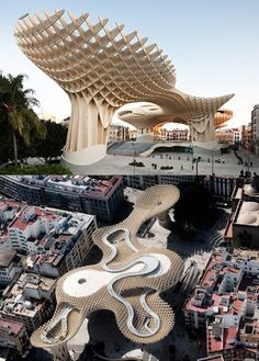 Metropol Parasol is a primarily wooden building located at La Encarnación square, in the old quarter of Seville, Spain. It was designed by the German architect Jürgen Mayer-Hermann and completed in April 2011. It has dimensions of 150 by 70 metres (490 by 230 ft) and an approximate height of 26 metres (85 ft) and claims to be the largest wooden structure in the world. Its appearance, location, and delays and cost overruns in construction resulted in much public controversy.