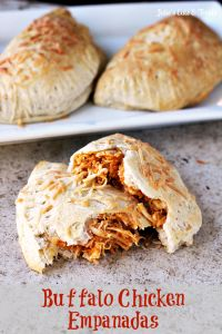 Buffalo Chicken Empanadas ~ Grands Biscuits stuffed full of Buffalo Chicken, Hot Sauce, Kraft Fresh Take, Swiss Cheese, Blue Cheese Dressing and baked to perfection! on MyRecipeMagic.com
