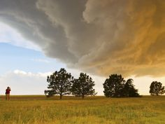 A Storm Chaser Watches a Massive Supercell Thunderstorm in Tornado Alley Photographic Print by Mike Theiss at AllPosters.com