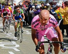 Italian Marco Pantani breakaways in the Mont Ventoux climb ahead of Spanish Roberto Heras (C) and German Jan Ullrich (L) during the 12th stage of the 87th Tour de France between Carpentras and Le Mont ventoux, southern France, 13 July 2000. Pantani won the stage ahead of US Lance Armstrong. Armstrong retains the yellow jersey. AFP PHOTO PATRICK KOVARIK (Photo credit should read PATRICK KOVARIK/AFP/Getty Images)