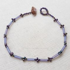 Gemstone Bugle Lilac Seed Bead Bracelet by sparkles4life on Etsy