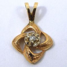 Estate Pendant in 14k Yellow Gold with an Accent Diamond Centered in a Square Shaped Swirl. - $350