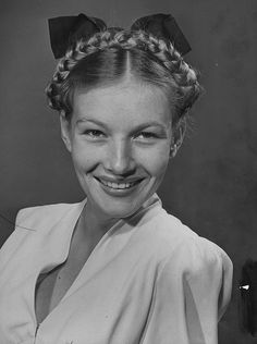 A very young, sweetly fresh-faced Veronica Lake sporting braided hair and a big bow