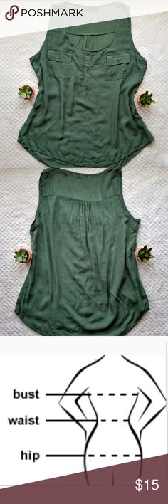 Green button front sleeveless blouse with pockets Bust: 18.5in Waist: 18.5in Hip: 21in Length front: 23in  Length back: 25in (measured in the center since the bottom is curved)  3 green buttons with gold trim down the front with two small pockets on bust. Curved hem on the bottom both in the front and back. Longer in the back and shorter in front. Slight pintucking on the center of the back. Lightwieght Rayon fabric. Pretty forest green color. mine Tops Blouses