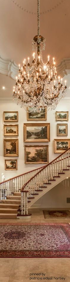 Fabulous gallery wall of landscapes in the entry foyer.