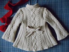 Double-breasted cabled jacket for girls - spectacular! Site is in Russian but you can translate and work it out from there. (sized for 3/4 years)