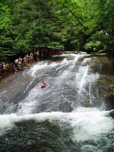 Sliding Rock, NC: A Favorite Natural Mountain Waterfall in the Pisgah National Forest, near Asheville NC. 60 ft flat boulder used as a waterslide, and an 8 ft deep pool. This is a fun family friendly activity. www.cullowheemoun...