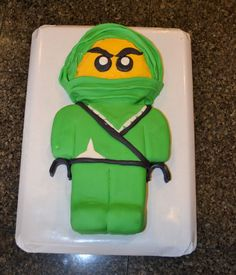 My son was obsessed with Ninjago and wanted his entire 4th Birthday to be all about the Green Ninja. Cake is covered MMF