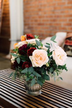 small floral centerpieces - photo by Plum and Oak Photo http://ruffledblog.com/a-must-see-industrial-wedding-with-gorgeous-florals