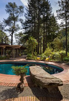 A huge rock that Liebermann picked out himself as as a diving board into the pool. Liebermann was very proud to design the house in a way that it reflects in the pool when you first walk in through the front gate. The reflection doubles the size of the house.