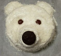 "Polar Bear cake... No recipe with this but-an 8"" round pound cake,cupcake snout, buttercream frosting, coconut on top then a choc covered oreo for the nose and choc candy for the eyes. Oh, and cut a cupcake in half for the 2 ears. Job done!"