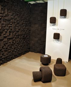 "Tania da Cruz' modular wall tiles ""Braque"" and the lamp ""Popcork"" are made of dark brown expanded #cork. #salonedelmobile"