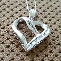 🎁🎄SALE! Stunning 10k Gold Diamond Heart Pendant This pendant is in excellent condition! Comes with 10k White Gold chain.  CHAIN NEEDS SMALL REPAIR! (See photo).  Will sell heart pendant on its own! Willing to accept offers! Would make a great gift! 1/8 CT TW Diamonds. Kay Jewelers Jewelry Necklaces