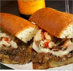 $100 Cheese Steak!  Barclay Prime in Philadelphia.  Yeah, that's lobster meat in there.  Saw on Best Food Ever.