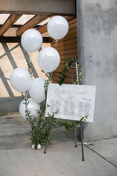 Wedding welcome sign. Simple and elegant with a touch of whimsy with the white balloons. Wedding welcome sign. Simple and elegant with a touch of whimsy with the white balloons. Table Seating Chart, Seating Chart Wedding, Wedding Table, Rustic Wedding, Ceremony Seating, Wedding Snack Bar, Nordic Wedding, Patio Wedding, Wedding Welcome Signs