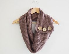 "20 Chic + Cozy DIY Scarves | Brit + Co. ""5. No-Sew Infinity Button Scarf: This is listed as no sew because it shows you how to use a toothpick instead of a needle to add a couple cute buttons. So fun! (via PS Heart)"""