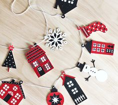 Christmas Village Garland by Rob & Bob. Make It Now in Cricut Design Space.