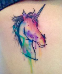 My watercolour unicorn tattoo by Charlotte Ross at Aurora Tattoos, Lancaster UK