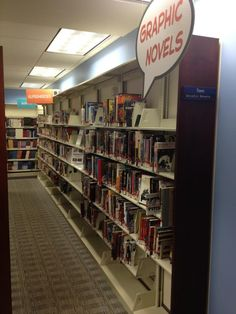 "Photo of the Kalamazoo Public Library Graphic Novel section, which is set up ""browsing style""--grouped into manga, superheroes, etc.  Love the sign!  https://sphotos-a.xx.fbcdn.net/hphotos-ash3/644066_10151102371313261_858401529_n.jpg"