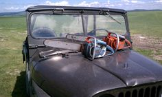 """The blue chainsaw is a 1972 Homelite XL-12 with a 16"""" bar. The red one is a 1979 Homelite Super XL AO with a 20"""" bar. Sitting pretty on a 1963 Jeep CJ-5."""