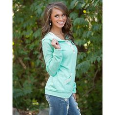 Two Toned Turquoise Sweatshirt Turquoise sweater shirt with hood in the back and 3 button detailing in the front. Pocket at the waste as well. Made of a cotton material. Size S,M Tops Tees - Long Sleeve