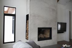 Your basement flooring options are not really any different from the flooring options elsewhere in your home. Everything from ceramics to hardwood, all are possible choices for your basement floor… Stucco Fireplace, Concrete Fireplace, Home Fireplace, Fireplace Remodel, Modern Fireplace, Fireplace Design, Fireplace Mantels, Fireplaces, Fireplace Ideas