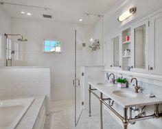 Gorgeous all white bathroom: love the medicine cabinets; glass enclosure; rain shower; double sink; lights; gooseneck faucets