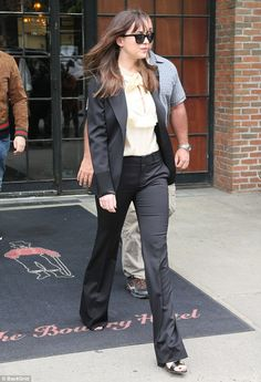Classy: Dakota Johnson, 27, kept it demure as she stepped out in a sophisticated suit in N...