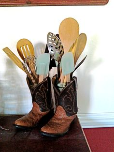 Outgrown little guy cowboy boots - place small Ball jar inside and create a new kitchen utensil holder - toss the crock!  http://jeansboots.blogspot.com/2011/09/born-again.html