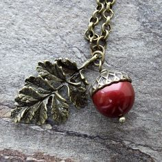 In Norway, an acorn is considered a symbol of good luck! (Swarovski pearl acorn and oak leaf pendant red by jinjajewellery, £12.00)