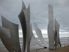 Omaha Beach in Normandy, France. Not only should you visit this part of the French coast because it's a huge part of American history, but you should also go because this is the only part of France where the locals will be nice to you. So refreshing. Normandy Beach, Normandy France, Travel Tours, Travel Ideas, Places Ive Been, Places To Go, Steel Art, Europe Photos, Paris Paris