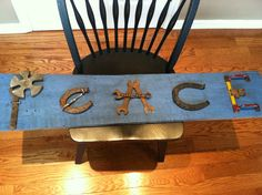 """Peace sign I made from tools,drawer pulls,ruler and a lock for the end """"e"""",horse shoes"""