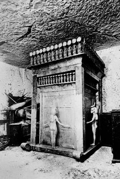 This is the canopic shrine of King Tut, containing the jars which contain the viscera of the King, seen Jan. 14, 1927. The shrine of gold is surmounted with glittering solar cobras and adorned on its four sides by the free-standing statuettes of the goddesses Isis, Nepthys, Neith, and Selkit.