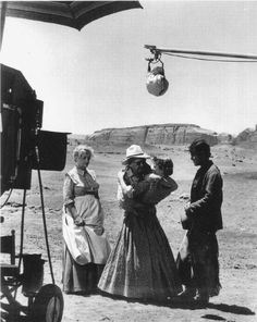 """John Ford gives Jeffrey Hunter direction on the proper way to kiss Vera Miles as Olive Carey looks on on the set of """"The Searchers"""" Golden Age Of Hollywood, Hollywood Stars, Jeffrey Hunter, The Searchers, John Ford, Western Movies, Western Film, Actor John, Cinema Film"""