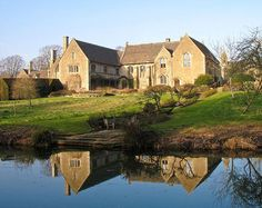 great chalfield manor completed in 1480 has a moat, a gatehouse, oriel windows and a great hall. the manor is part of the national trust.