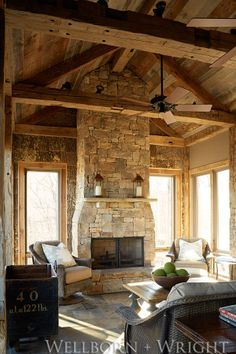 reclaimed barn siding + hand-hewn beams + rustic, cozy living room. - Wellborn + Wright