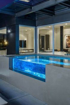 Very cool glass-sided swimming pool on large patio. Very cool glass-sided swimming pool on large patio.