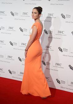 Emily Blunt booty in an orange dress