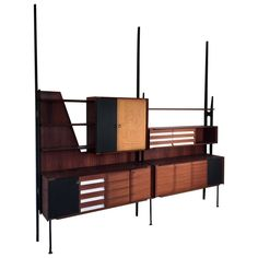 Sculptural Italian 1950s Bookcase and Sideboard by Vittorio Dassi | From a unique collection of antique and modern bookcases at https://www.1stdibs.com/furniture/storage-case-pieces/bookcases/