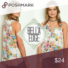 🆕 Bold colorful floral lace up tank top 💎100% POLYESTER 💎This bold and bright floral tops has a watercolor look to it that is absolutely stunning. With fashionable lace up chest to neckline, it's sure to get you plenty of compliments. Sleeveless, relaxed fit.  💎Sizes small to large Bella Edge Boutique Tops Tank Tops