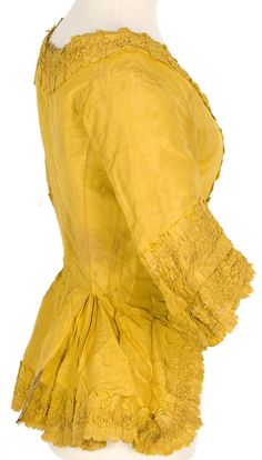 Imatex - polonaise jacket; close up of cut with pinked scalloped edges, ruched.  You can also see the top-stitched side seam