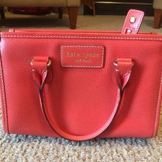 Authentic Orange/Red Kate Spade. Final Price Drop!! $80 Very cute Kate Spade! Pictures don't do this justice! Looks small but pretty roomy inside! Great purse! REASONABLE OFFERS WELCOME WITH OFFER BUTTON kate spade Bags Mini Bags