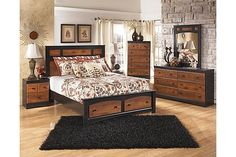 "The Aimwell Panel Bed w/ Storage from Ashley Furniture HomeStore (AFHS.com). With the rustic beauty of the warm brown finish enhancing the replicated cherry grain along with the deep black finish that features golden rub through accenting, the two-toned look of the ""Aimwell"" bedroom collection captures a vintage casual atmosphere to enhance any bedroom's décor."