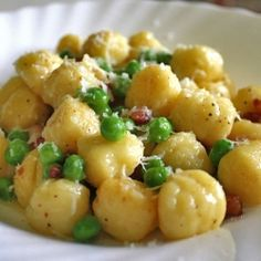 Gnocchi with peas, pancetta and pecorino. An easy weeknight meal for chilly winter night and sweltering summer days.