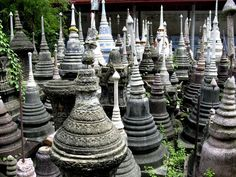 Funerary Stupas - Thailand. Essentially symbolic headstones... creating one will give you good fortune in your rebirths, while destroying one is viewed as a negative act that will leave a karmic mark on you for bad rebirths forever.