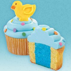 Greet the little one to come with happy cupcakes topped with a cookie chick. Guests will get their own surprise—a blue center, created with our Two-Tone Cupcake Set.